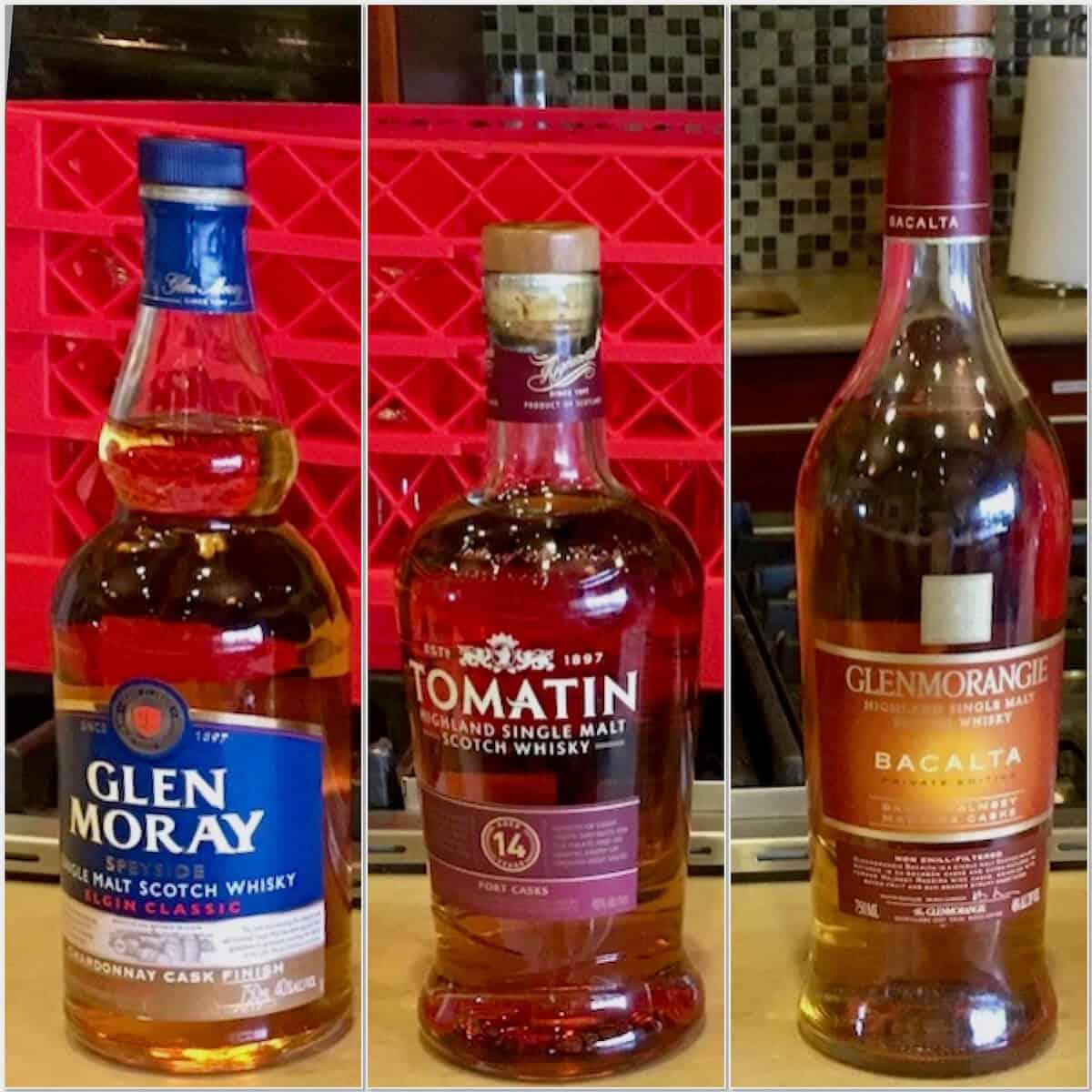 Collage of Glen Moray, Tomatin, and Glenmorangie scotch bottles on a counter.