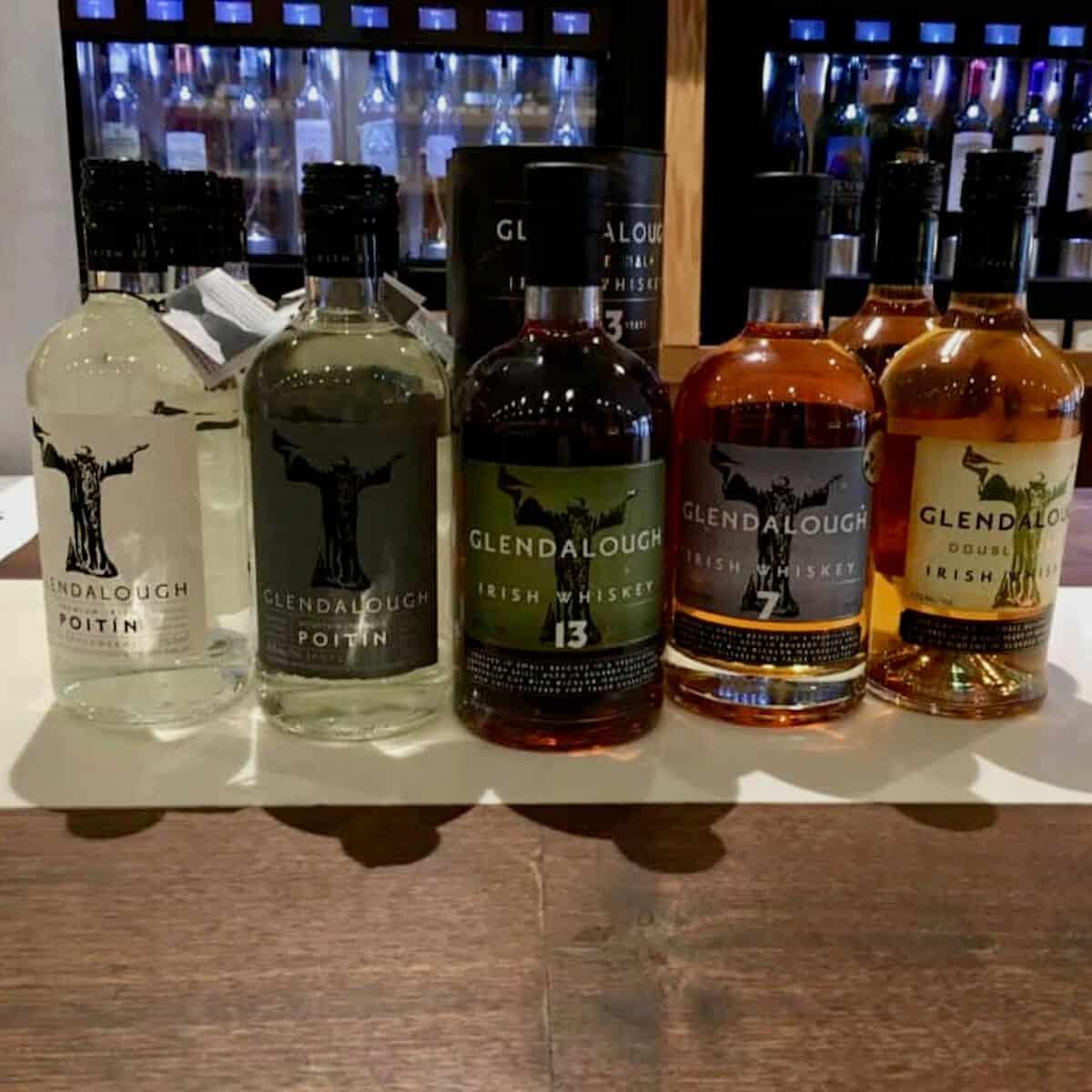 Glendalough Irish whiskey lineup in bottles on a counter.