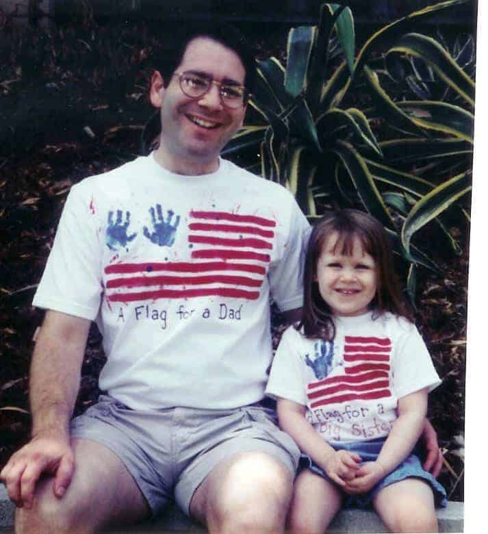 Author's husband and older daughter wearing matching Father's Day Flag shirts