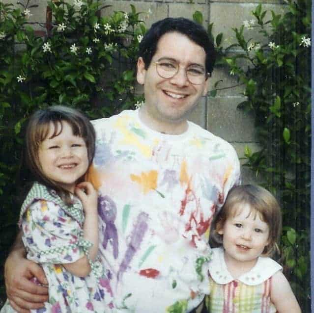 Author's husband and daughters with Dad wearing an abstract-design Father's Day shirt