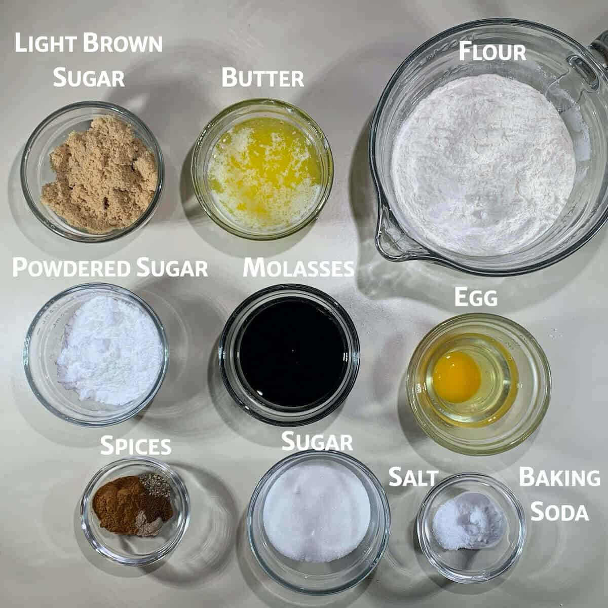 Molasses cookies ingredients in glass bowls from overhead.
