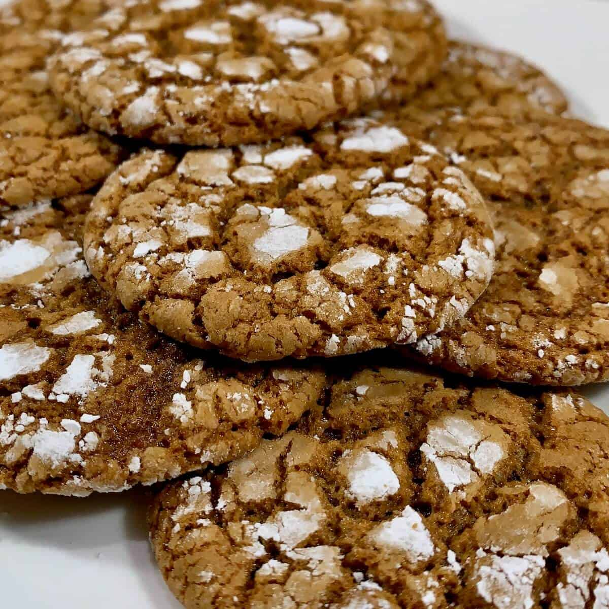 Stacked molasses cookies showing texture.