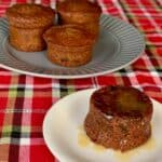 Sticky Toffee Pudding plated on plaid with more in background