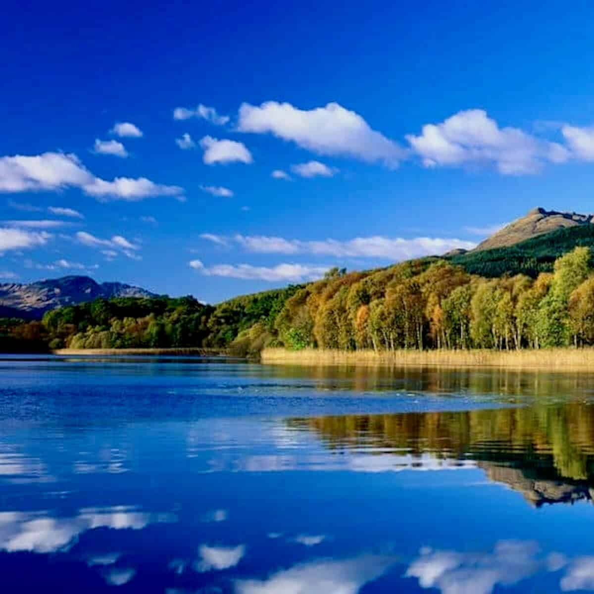 Scene of Scotland's Loch Lomand water and hills.