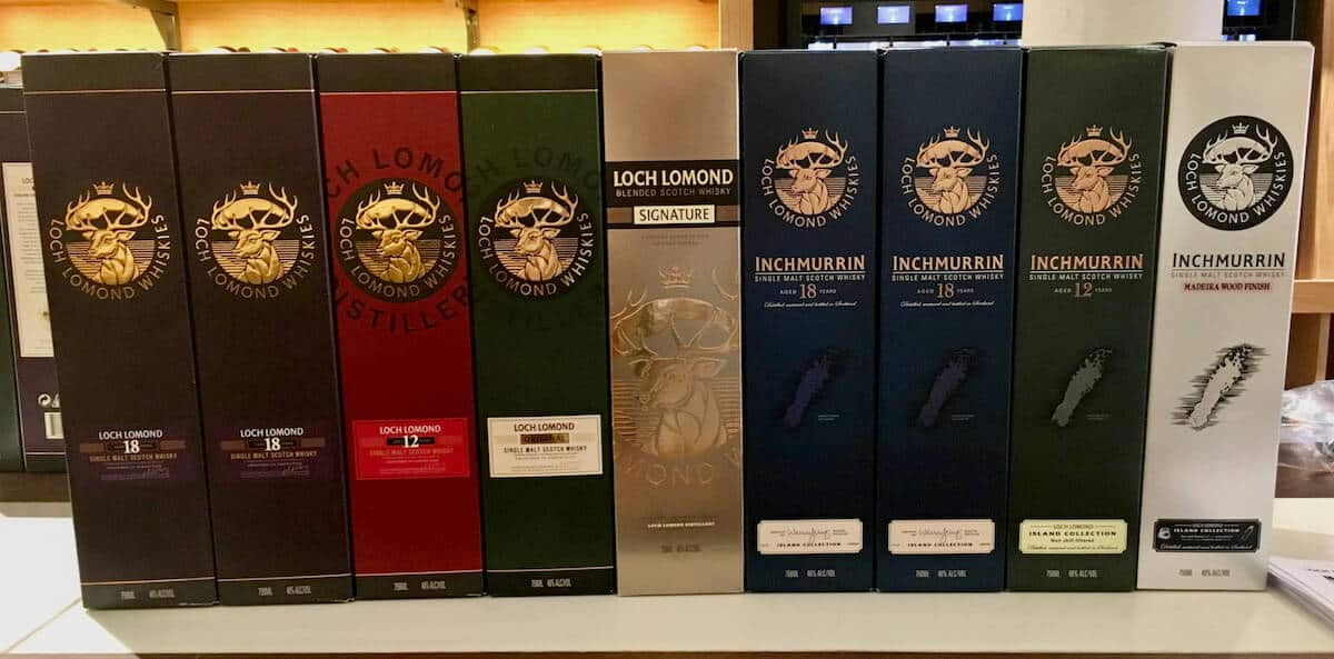 Loch Lomond whisky lineup boxes on a counter.