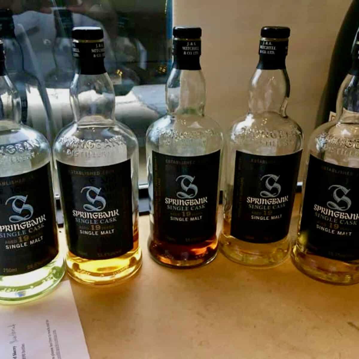 Springbank Single Malt Oak Exploration lineup bottles on a table.