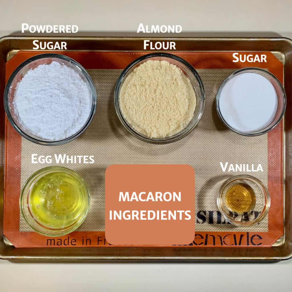 Macarons ingredients on tray from overhead marked