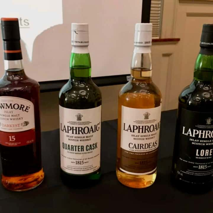 Laphroaig and Bowmore scotch tasting lineup in bottles on a table.