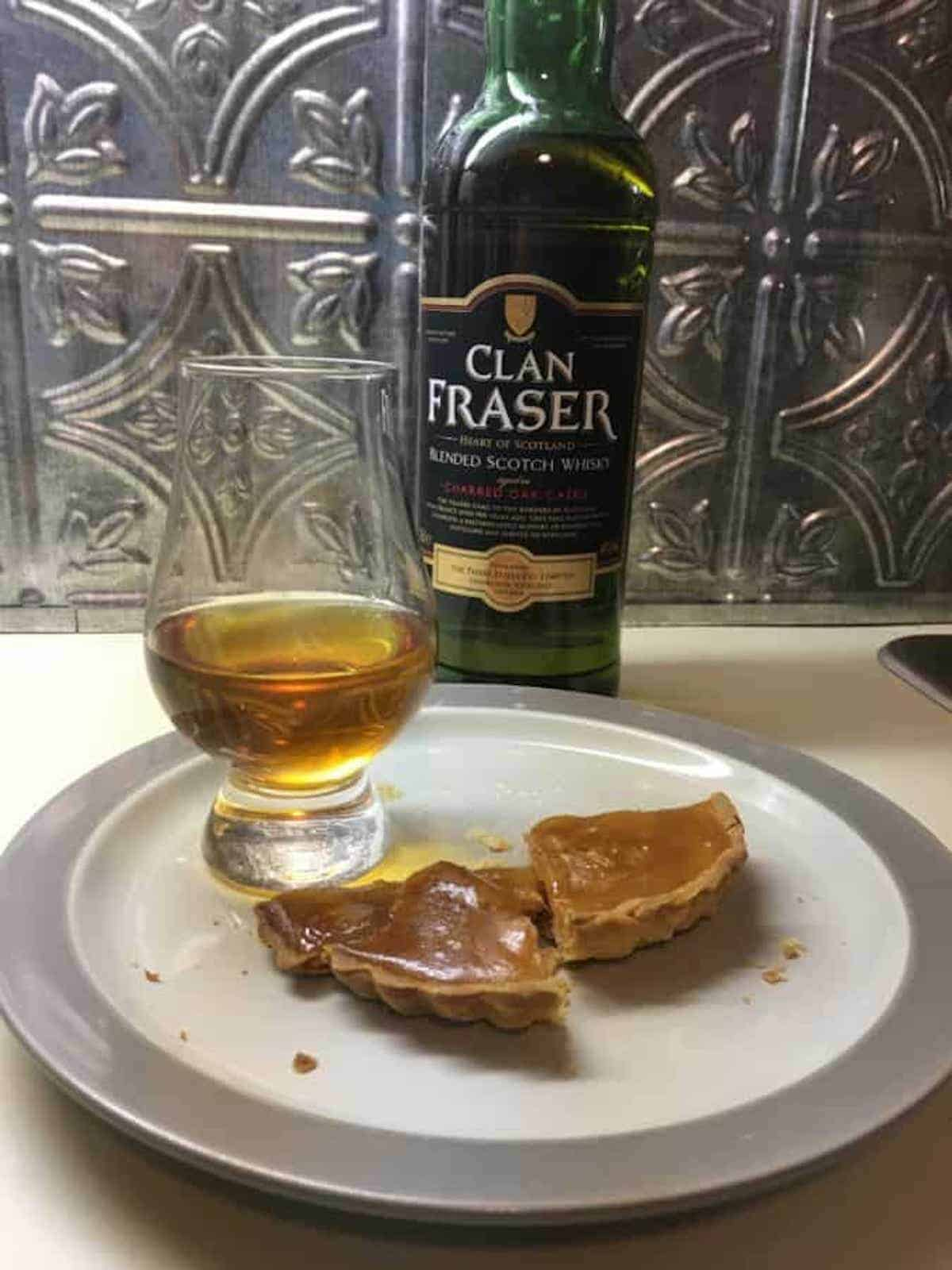 Clan Fraser blended scotch whisky with poured glass & apple cider tart