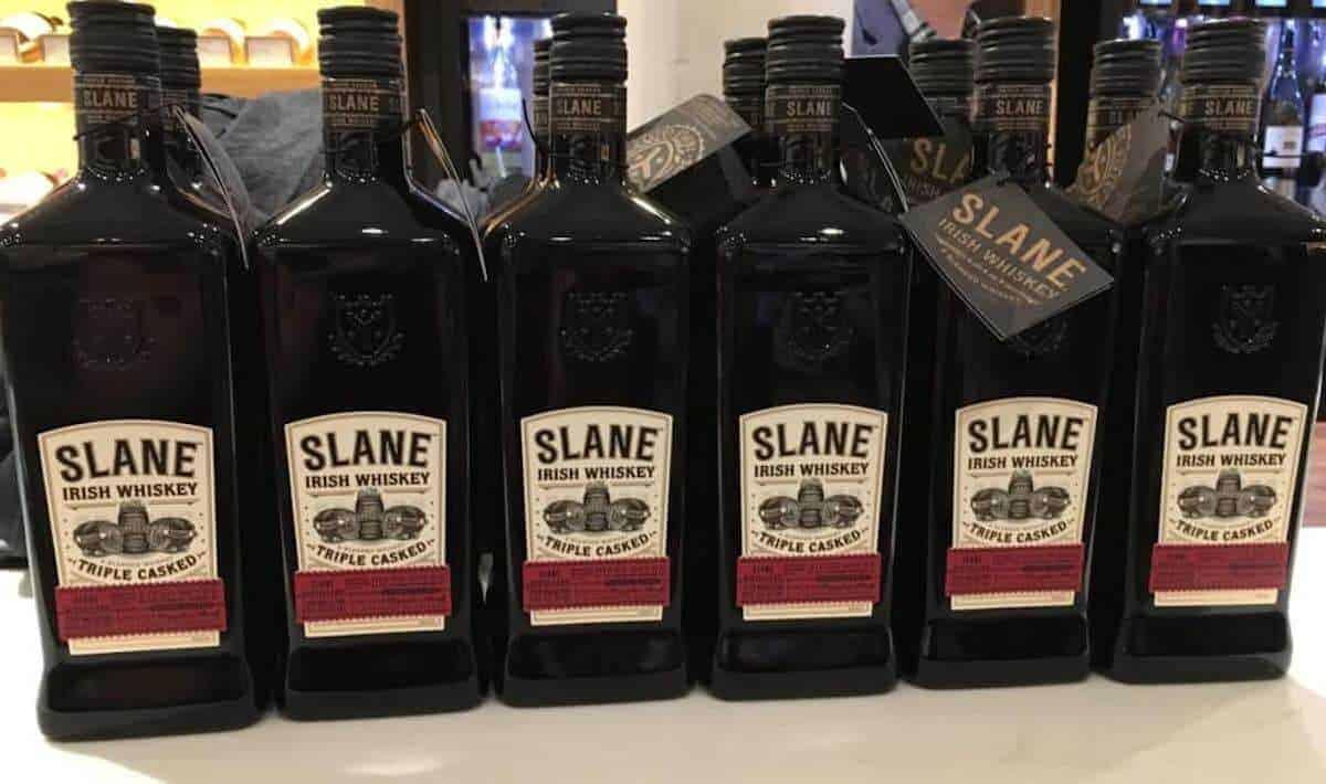 Slane Irish Whiskey bottles on a counter.