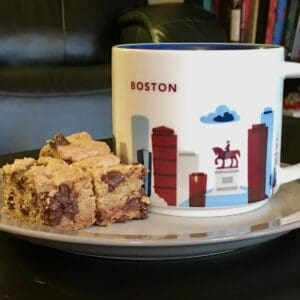 Chocolate Chip Cookie Bars plated with Boston mug