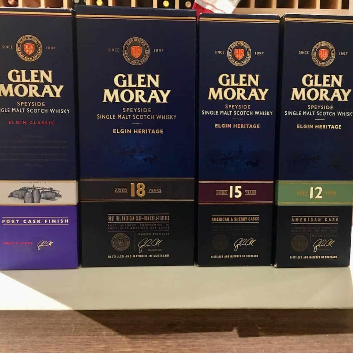 Glen Moray whisky box lineup on a counter.
