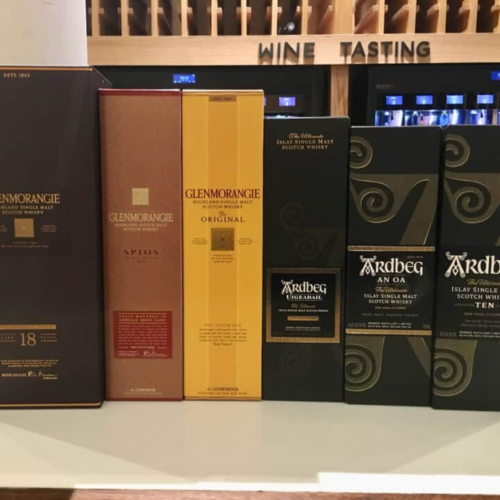 Glenmorangie and Ardbeg lineup in boxes on a counter.