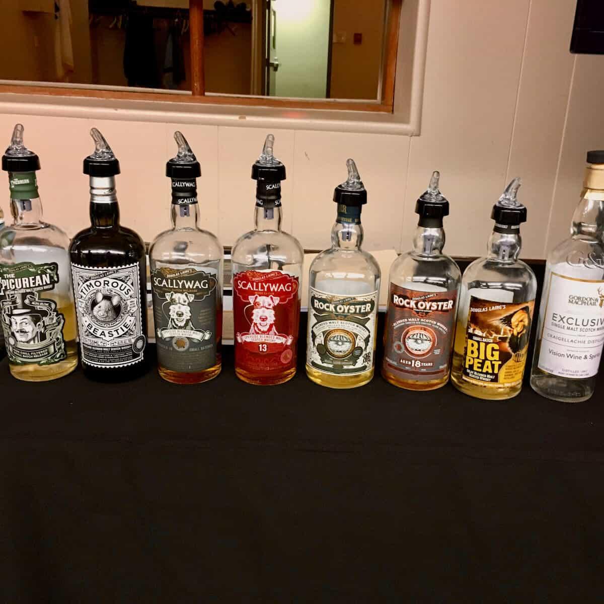 Douglas Laing Remarkable Regional Malt lineup in bottles on a table.