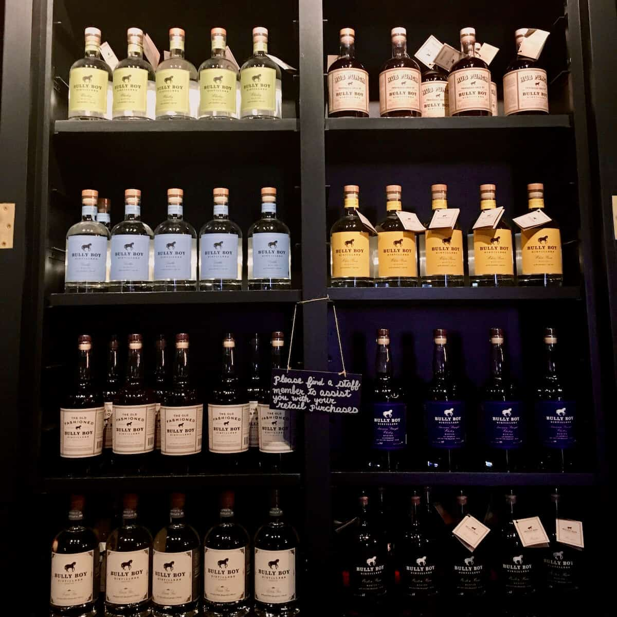 Bully Boy Distillery bottles on shelves.