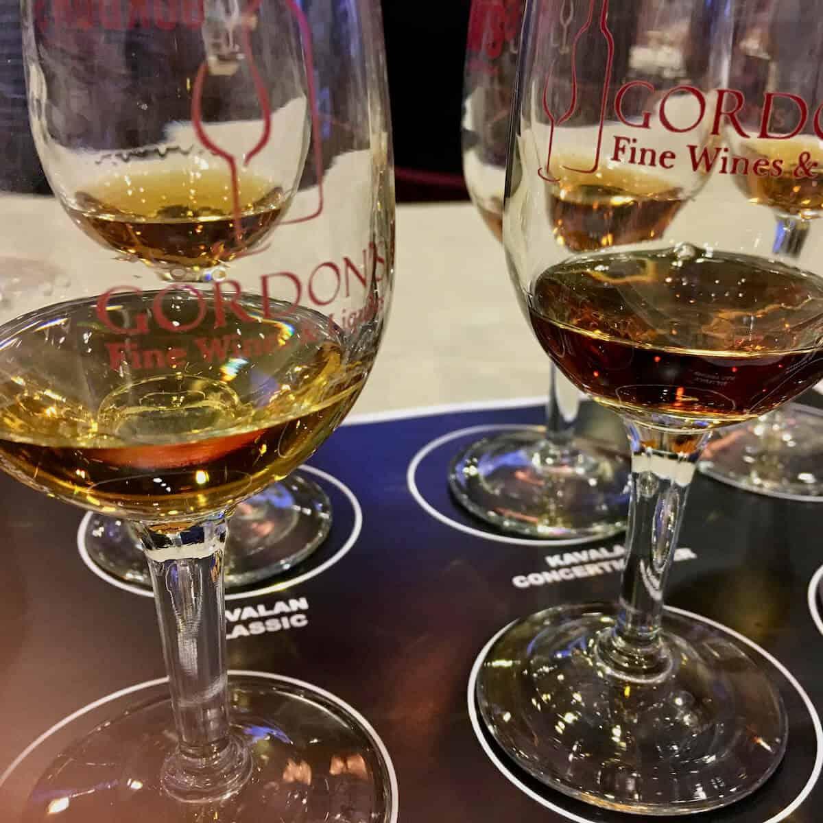 Kavalan whisky seminar tasting lineup in glasses on a sample mat.