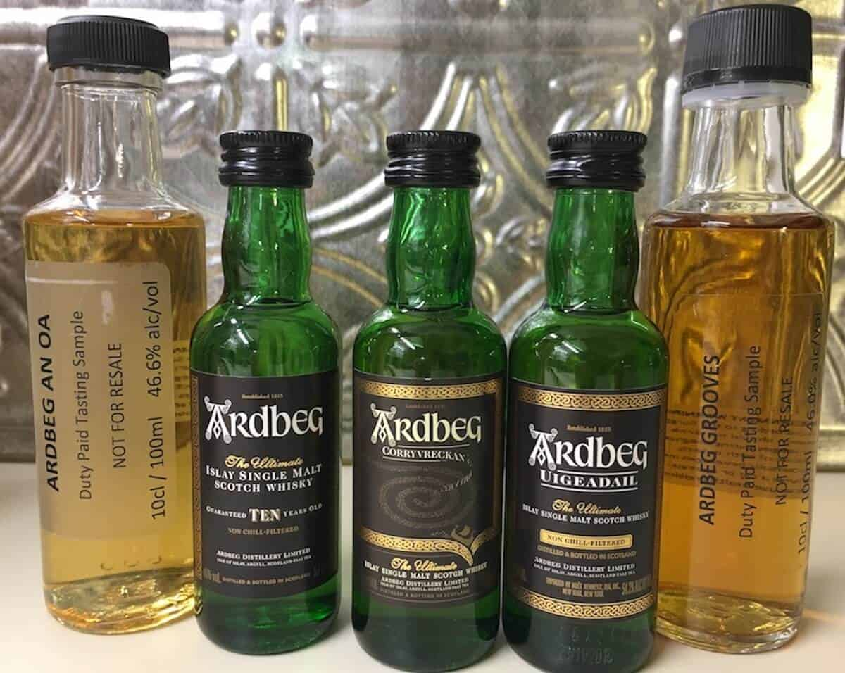 Ardbeg Day sample lineup bottles on a counter.