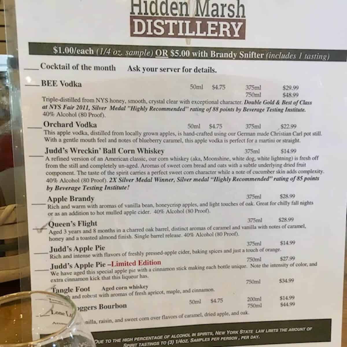 Hidden Marsh Distillery tasting room menu printout.