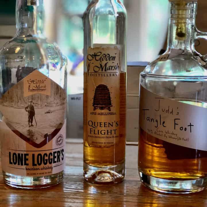 Hidden Marsh Distillery tasting lineup bottles on a counter.