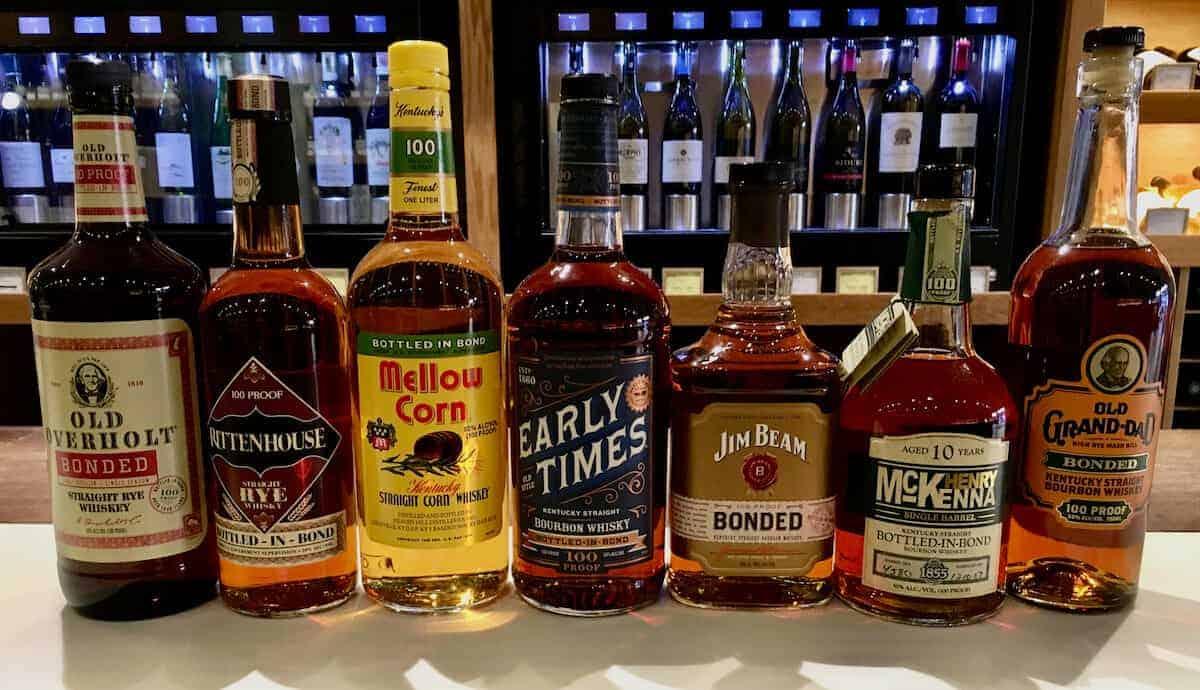 Bottled in bond bourbon lineup in bottles on a counter.