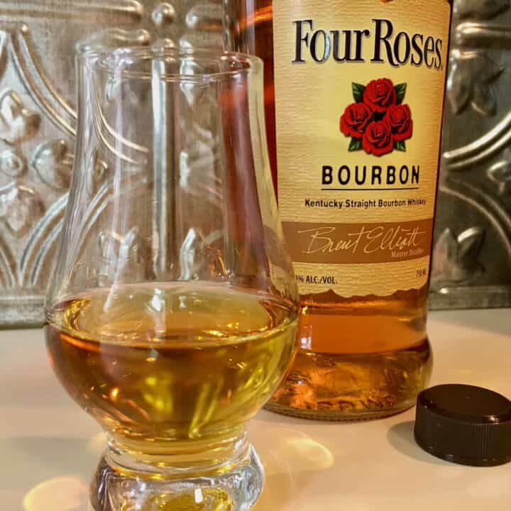 Four Roses Bourbon bottle with poured glass