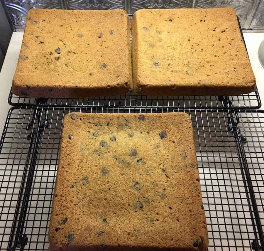chocolate chip cookie cake layers cooling on a rack