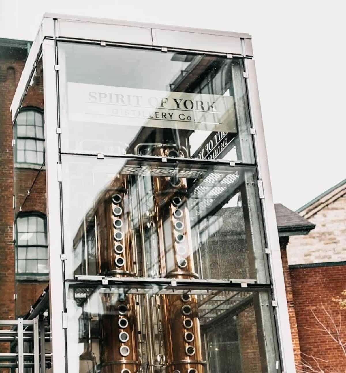 Spirit of York distillery's glassed-enclosed column still.