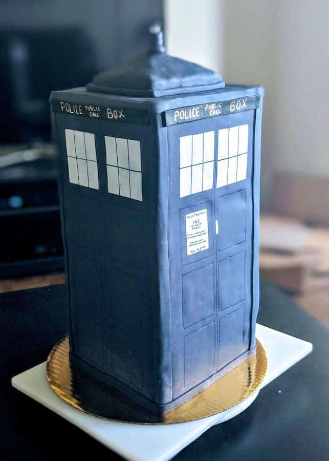 groom's finished TARDIS cake on a stand