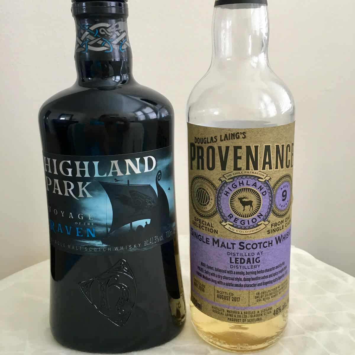 Highland Park Voyage of the Raven and Douglas Laing Provenance in bottles on a table.