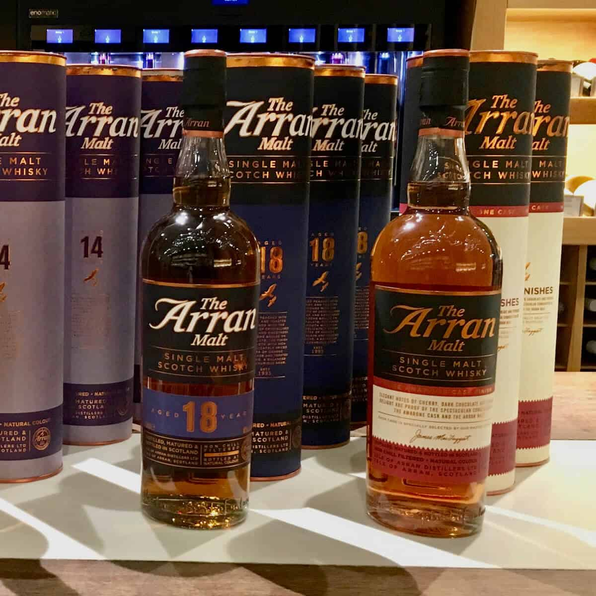 Bottles and sleeves of Arran Malt 18 year & Amarone finish on a counter.