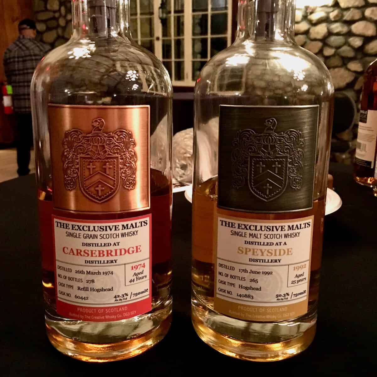 Exclusive Malts Carnebridge & Speyside bottles on a table.