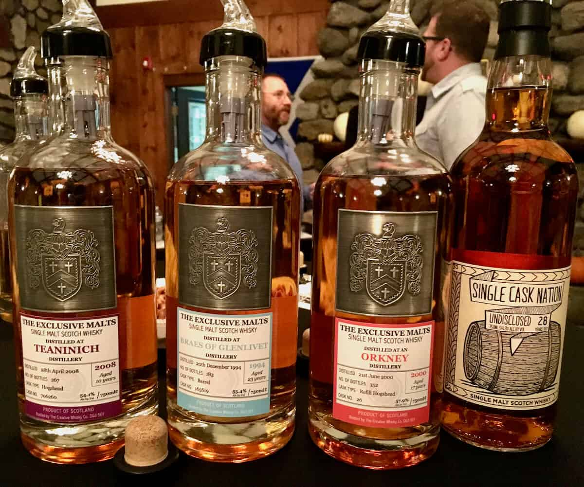 Exclusive Malts Teaninich, Braeval, Orkney, & SCN Undisclosed bottles on a table.