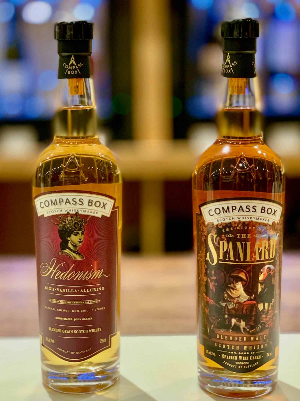Compass Box Blended Scotch Hedonism and Spaniard in bottles on a counter.