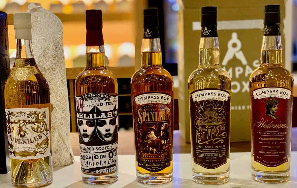 Compass Box Blended Scotch lineup in bottles on a counter.