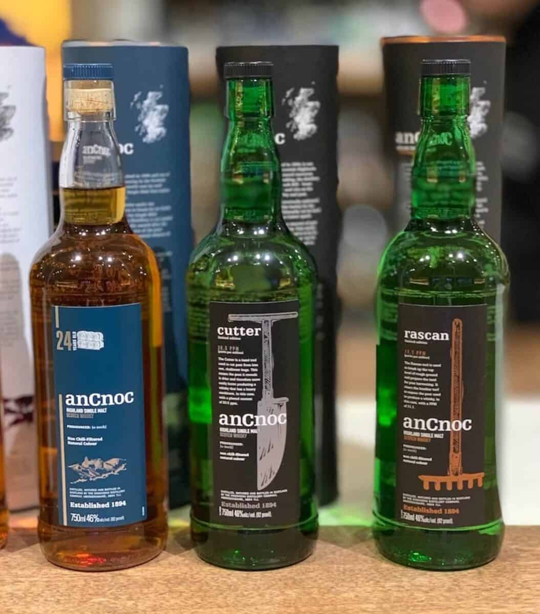 anCnoc rascan, cutter, and 24 in bottles on a counter.