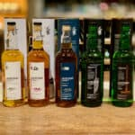AnCnoc lineup in bottles on a counter.
