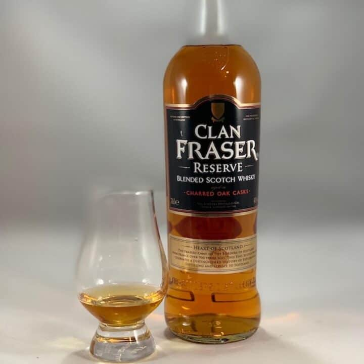 Clan Fraser Reserve blended scotch bottle with poured glass next to it.