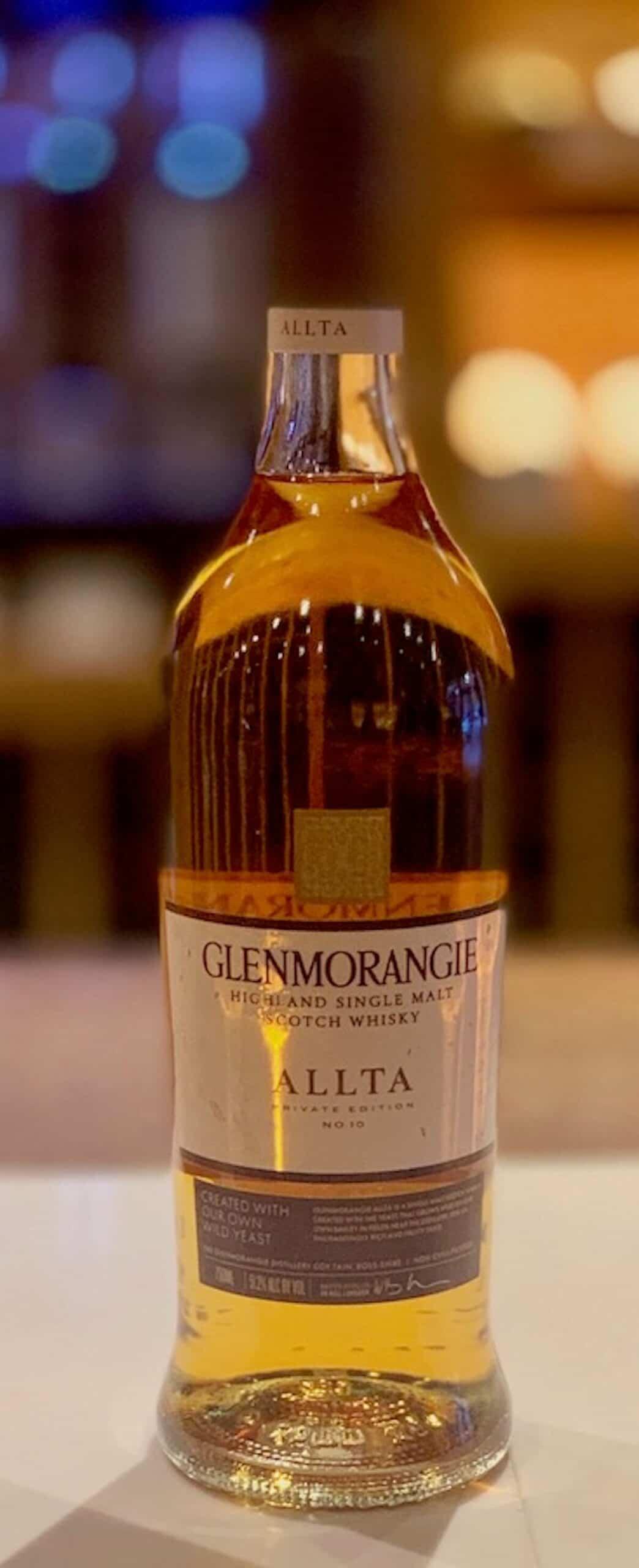 Glenmorangie Allta in bottle on a counter.