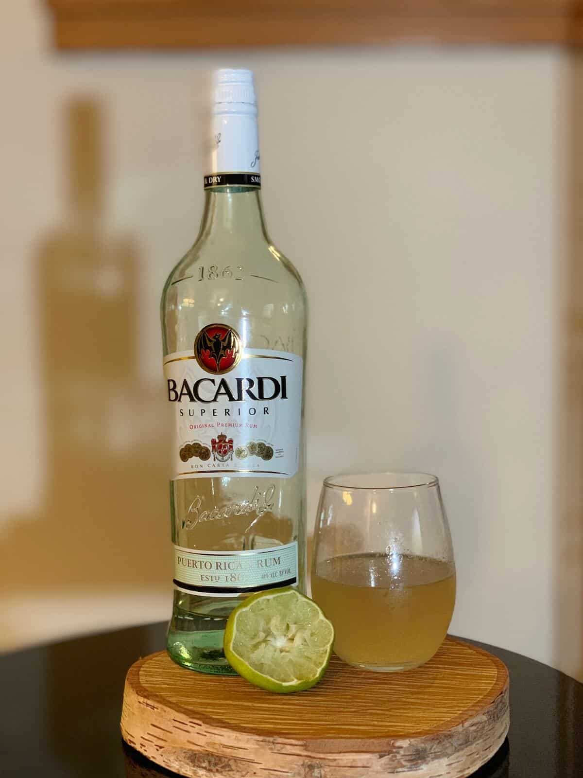 Daiquiri in glass with Bacardi Rum and lime on a table.