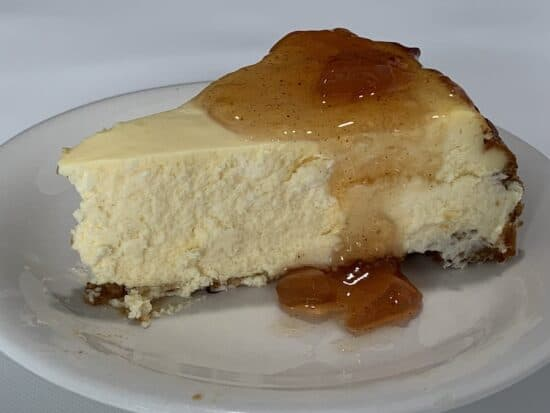 White Wine cheesecak slice topped with What'ta Pair jam