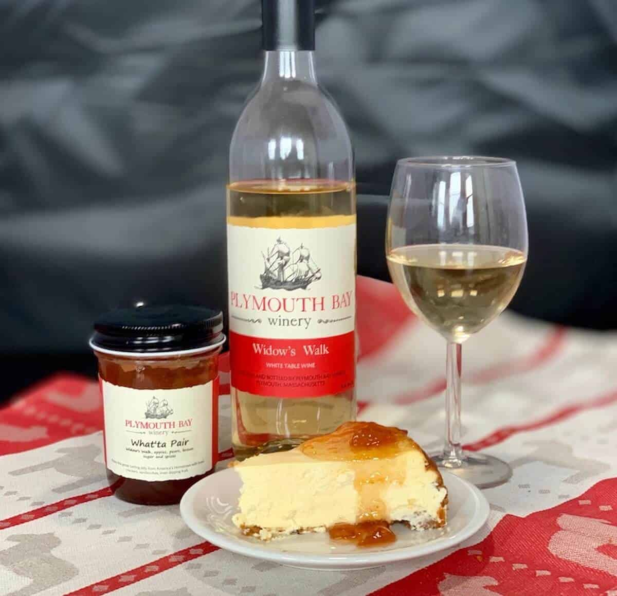 White Wine cheesecake plated with wine and jam in bottles
