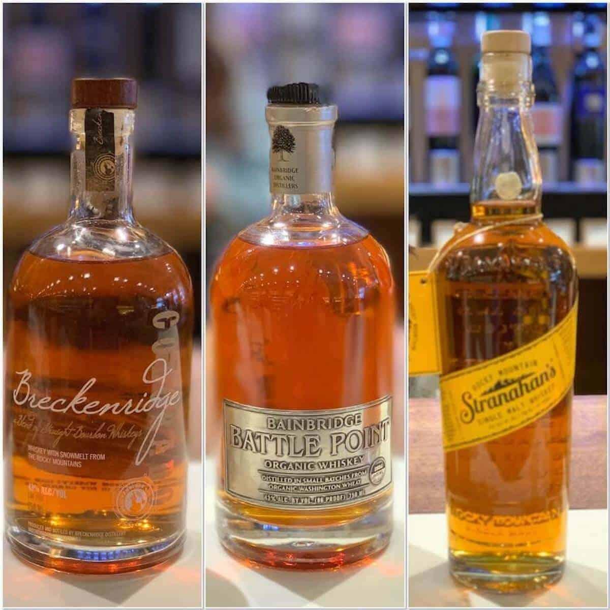 Collage of Bainbridge, Breckinridge, Stranahan's whiskey bottles on a counter.
