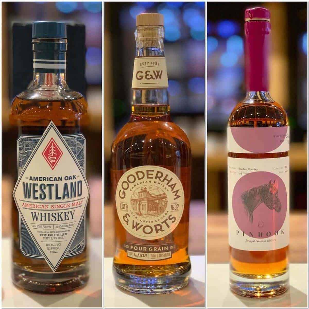 Collage of Westland, Gooderham & Wort, and Pinhook whiskey bottles on a counter.