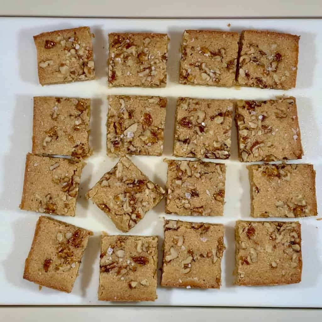Maple Walnut Bourbon Blondies cut on cutting board