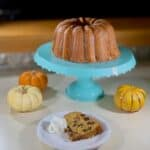 sourdough pumpkin cake on cake stand with plated slice