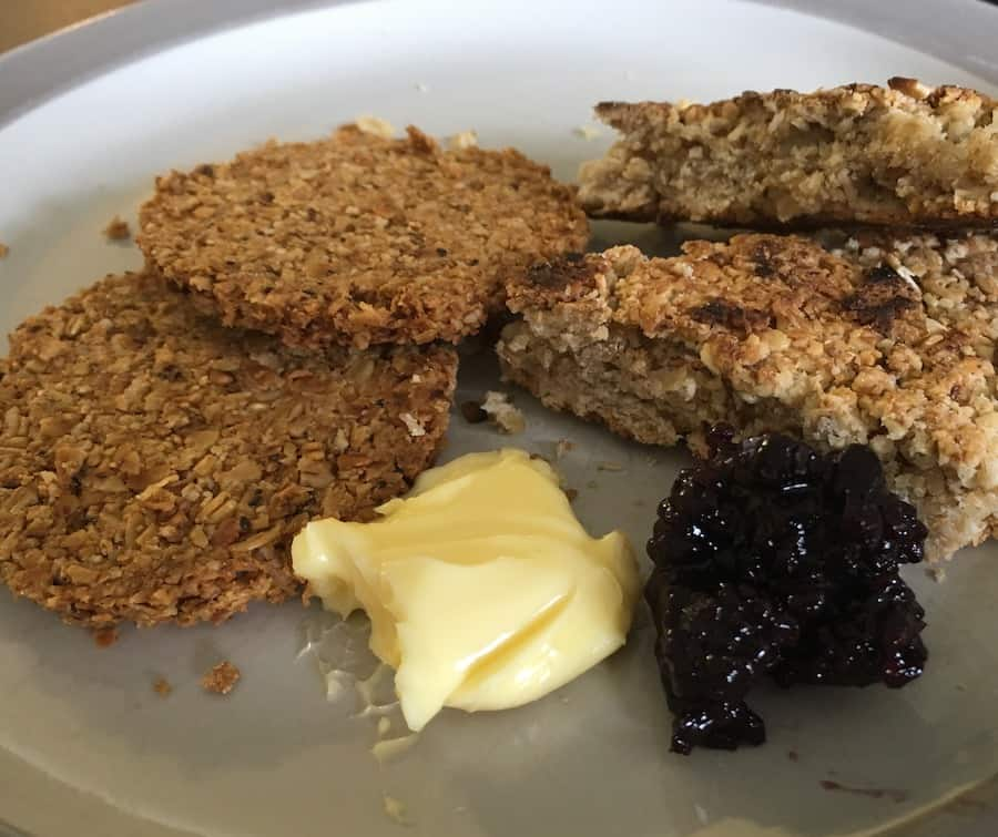 two types of bannocks plated with butter & jam