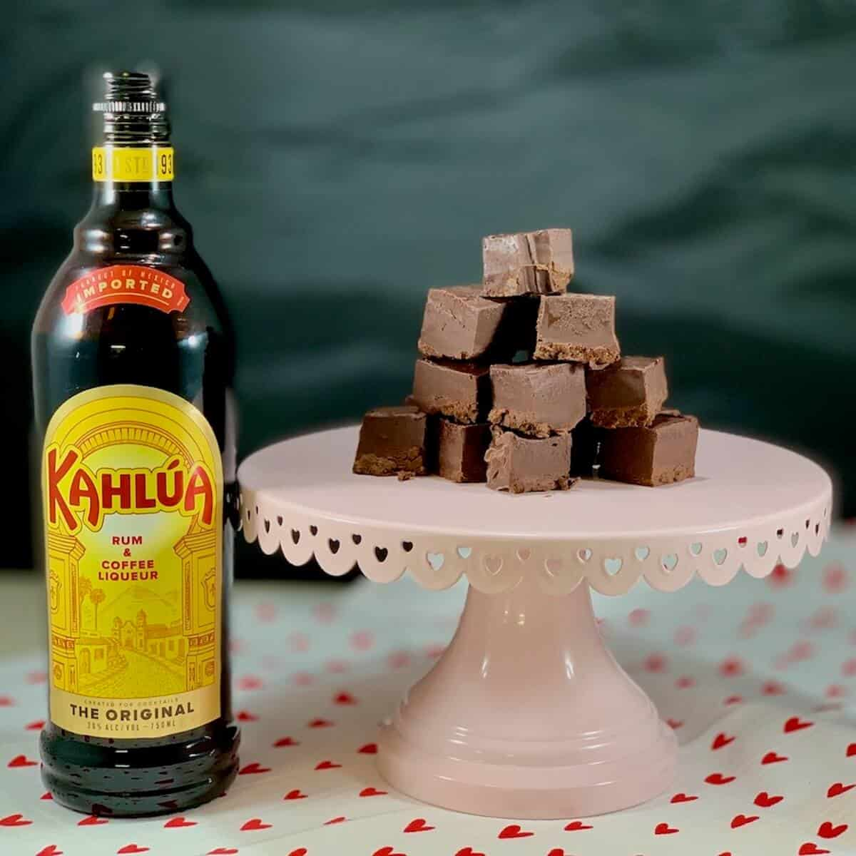 Kahlua Chocolate Fudge stacked on a cakestand with a bottle of Kahlua