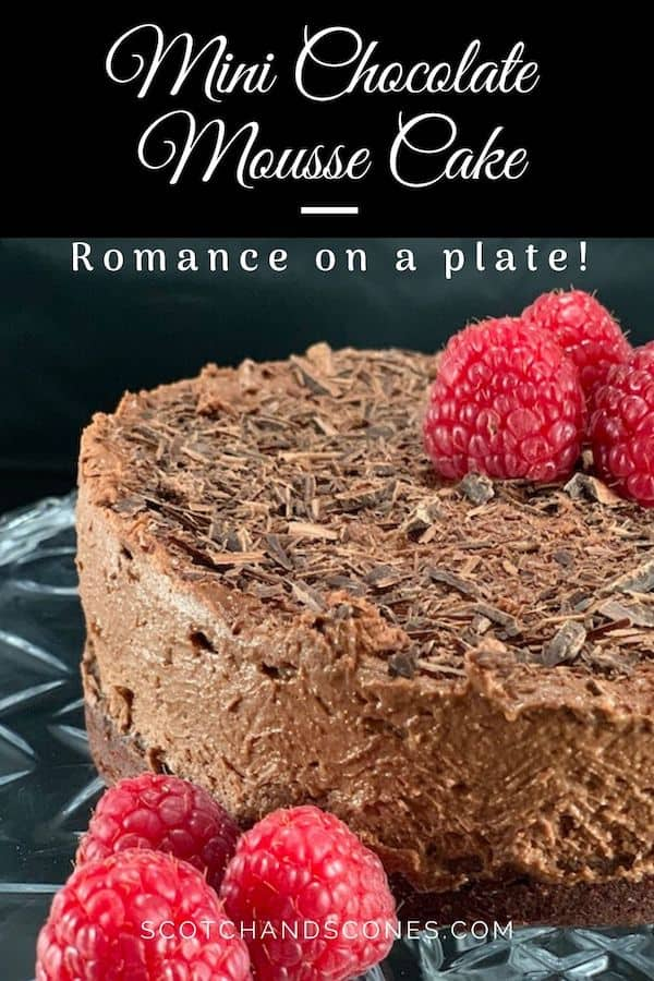 Mini Chocolate Mousse Cake on cake stand with raspberries Pinterest banner