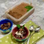 Chocolate Mint Chip gelato in bowls with tub of gelato square