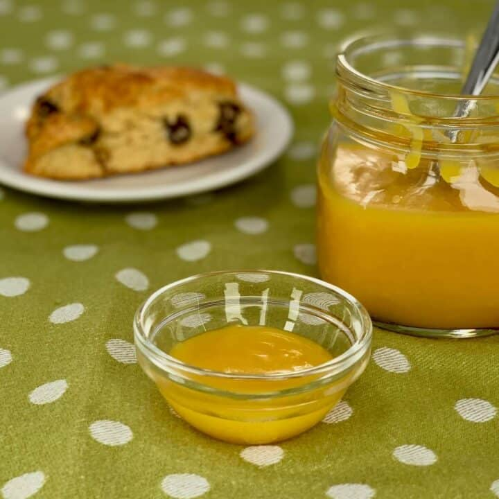 lemon curd in bowl with scone closeup